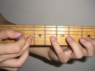 Guitar Tapping with middle fingers