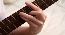 holding a barre chord